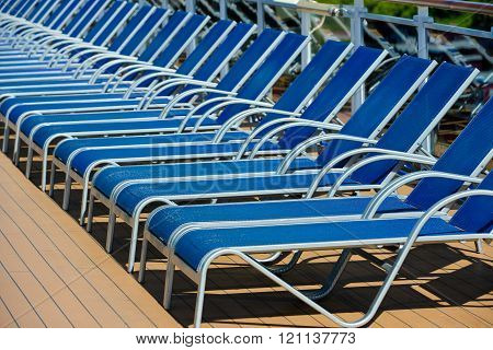 A Lot Of Blue Sunbed Into A Cruise Ship On Summer Day