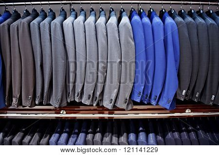 Elegant Blue And Gray Suits In A Store