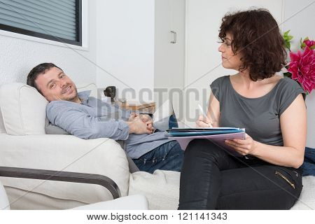 Psychologist Talking With Happy Man In The Office