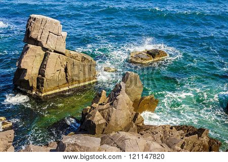 Sea Wave Breaks About Rocky Shore