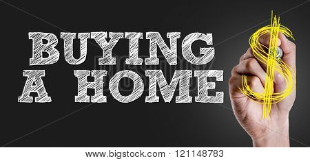 Hand writing the text: Buying a Home