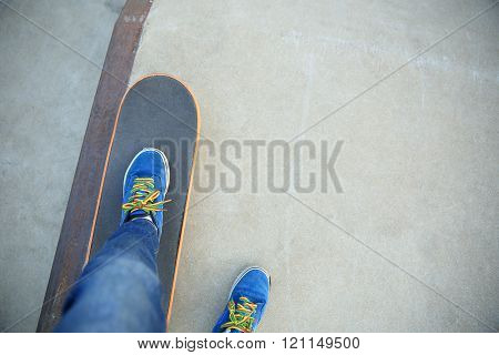 closeup of skateboarding legs at skate park