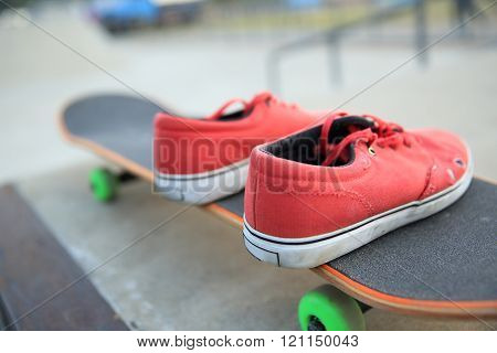 closeup of skateboarding  sneakers at skate park