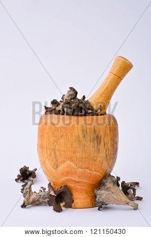 Dried mushrooms in mortar