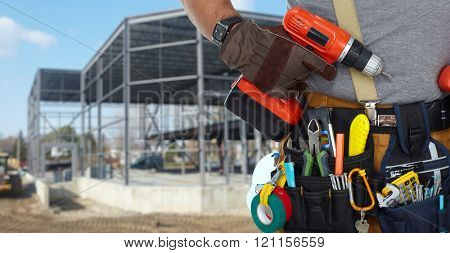 Builder handyman with drill.