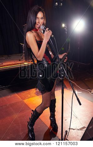Glamorous girl singing on the stage
