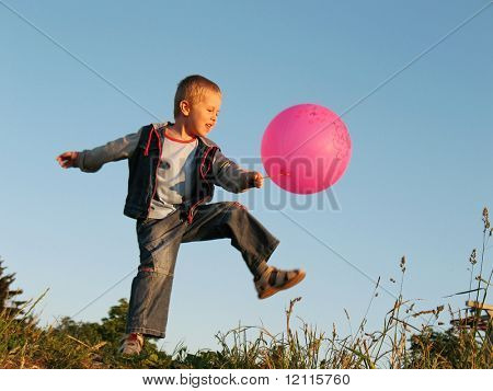 child play with red ball