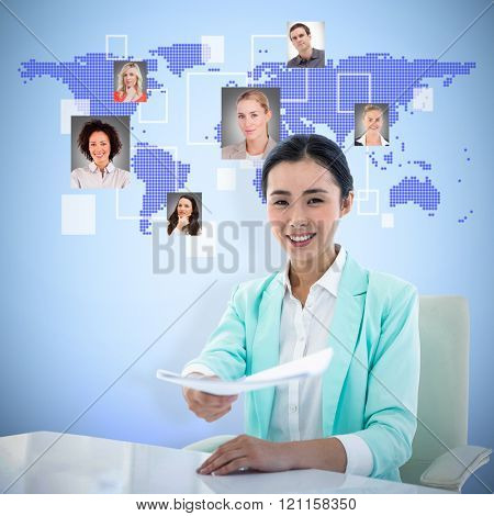 Smiling businesswoman taking notes against blue background