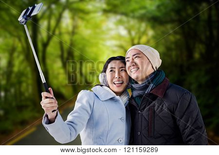 Smiling couple taking selfie against country road