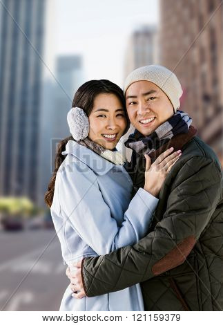 Portrait of couple embracing against new york street