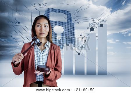 Businesswoman banging a law hammer on the gavel against graph on circuit board