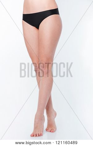 Closeup portrait of a sexy female legs on white background
