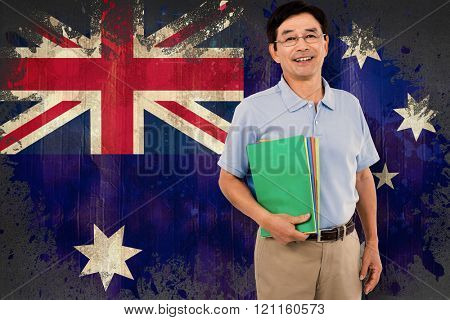 Portrait of happy businessman with files against australia flag in grunge effect