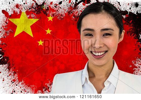 SMiling businesswoman looking at the camera against china