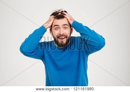 Cheerful amazed man looking at camera isolated on a white background