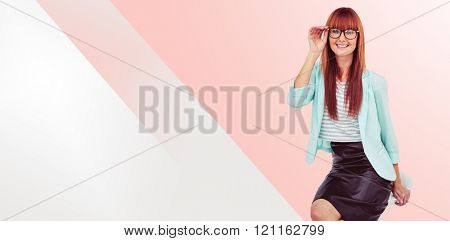 Portrait of a smiling hipster woman against grey background