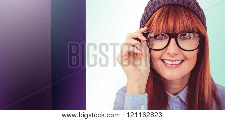 Smiling hipster woman looking at camera against green vignette