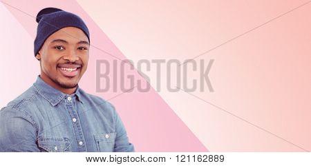 Handsome man against pink background