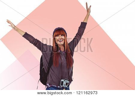 Smiling hipster woman with hands up against rosa beige and white