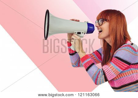 Smiling hipster woman shooting through megaphone against rosa beige and white