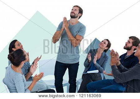 Rehab group applauding delighted man standing up against colored background