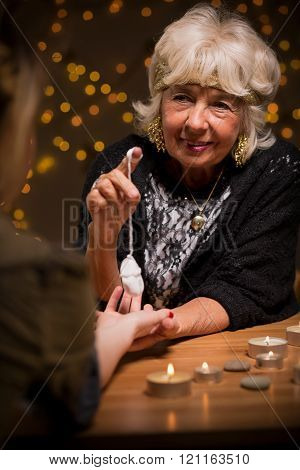 Fortune Teller With A Pendulum