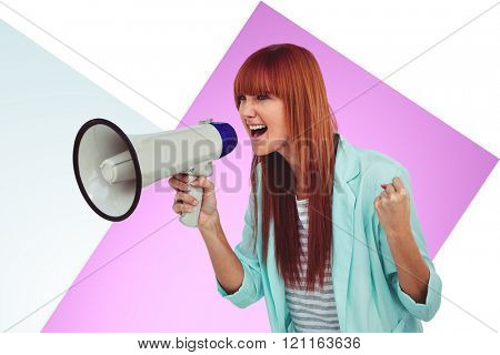 Hipster woman shooting through megaphone against rosa and white