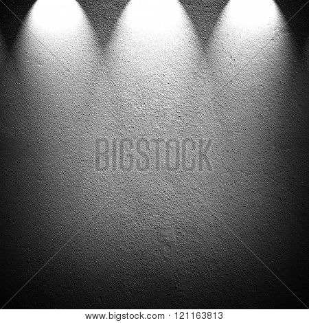 concrete wall with 3 spotlight background