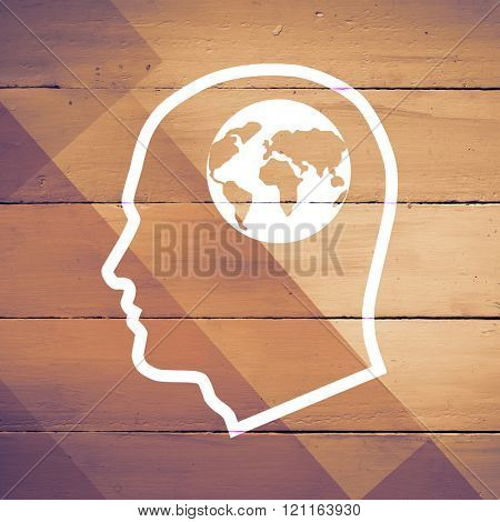 Earth in head against colored wood