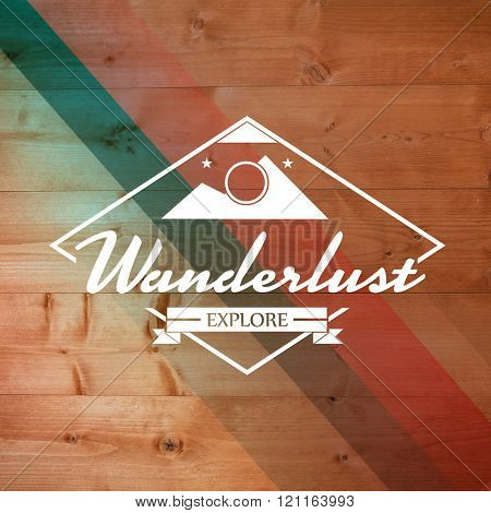 Wanderlust word against colored wood