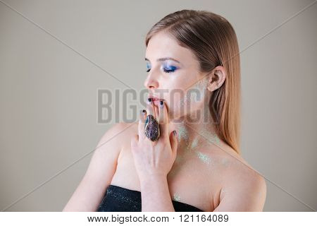 Beauty portrait of attractive woman posing over gray background
