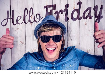 Cheerful hipster wearing sunglasses against wooden background
