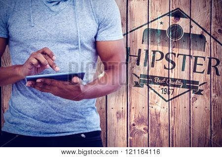 Mid section of man using tablet against wooden planks background