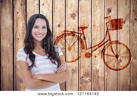 Pretty woman with arms crossed against wooden planks background