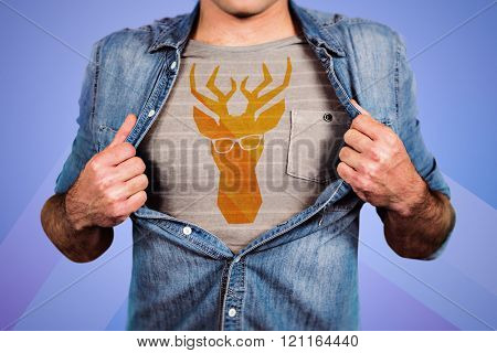 Funny blond hipster taking off his shirt against colored background