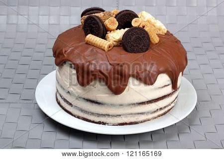 Cake, glazed with milk chocolate and decorated with waffles and cookies