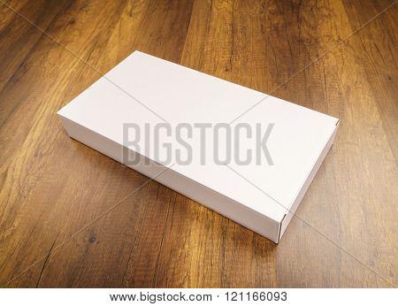 Blank white box mock up on wood background