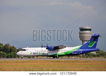 MASwings airplane taxiing at Kota Kinabalu International Airport