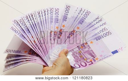 a fan with 500 euros seem held in a hand