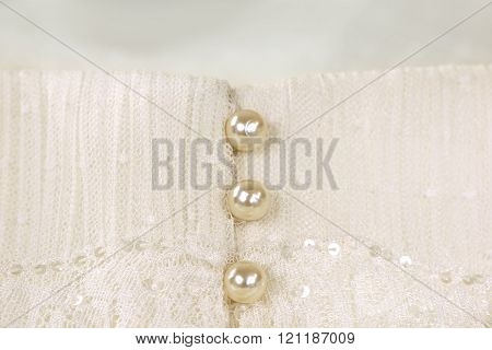 Pearl buttons on ivory wedding dress