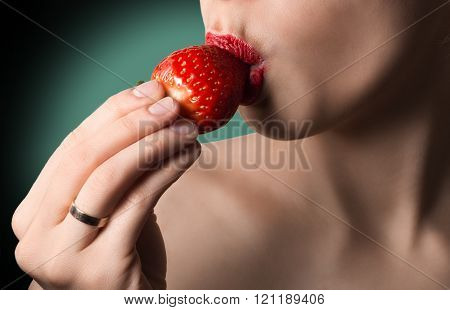 Sexy Lips With Strawberry. Natural Skin. Green Background. Hot Kiss.