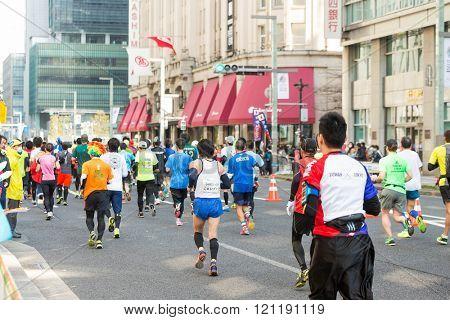 TOKYO, JAPAN - FEBRUARY 28 2016: Marathon in Tokyo Japan downtown. Marathon race in Tokyo