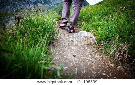 Woman trekking on mountain path