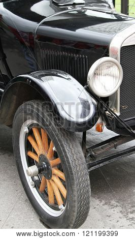 Wheel, Fender And Headlight Of Old Car