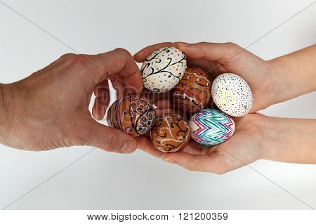 Colorful Easter Eggs On Burlap, Female Hand Chose And Pick One Egg