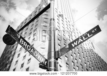 Wall Street and Broadway sign in Manhattan, New York, USA.