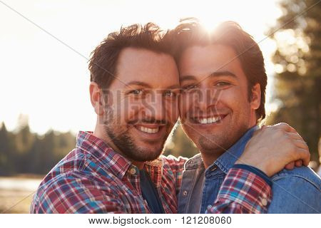 Head And Shoulders Portrait Of Romantic Male Gay Couple