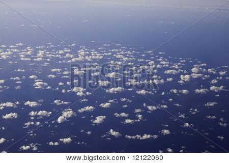 Clouds from above with ocean below