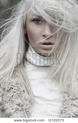 Portrait of a beautiful girl wearing white fur