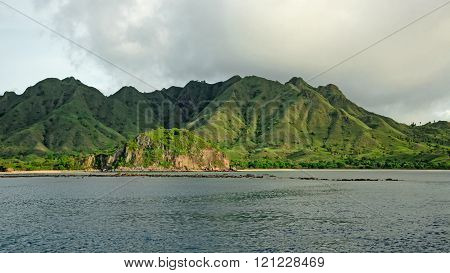 Green Island, hills covered with tropical vegetation in Indonesia ** Note: Visible grain at 100%, best at smaller sizes